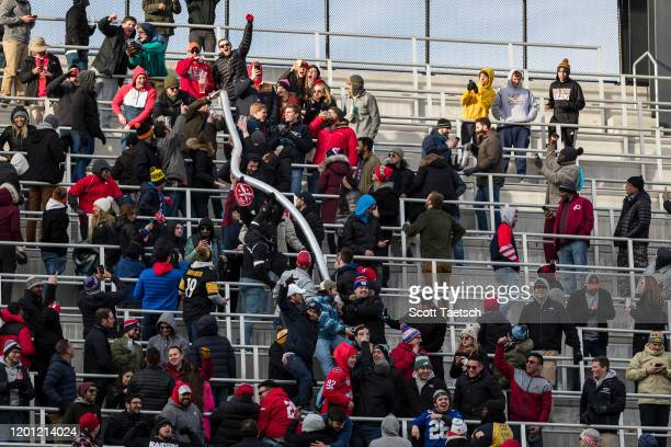 Fans create a large beer cup snake in the stands during the second half of the XFL game between the DC Defenders and the NY Guardians at Audi Field...