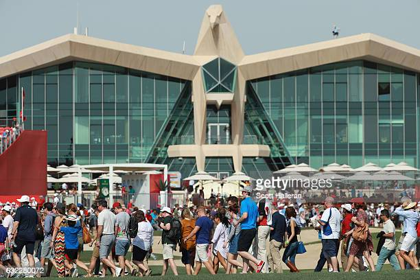 Fans cross the fairway on the ninth hole during the third round of the Abu Dhabi HSBC Championship at Abu Dhabi Golf Club on January 21 2017 in Abu...
