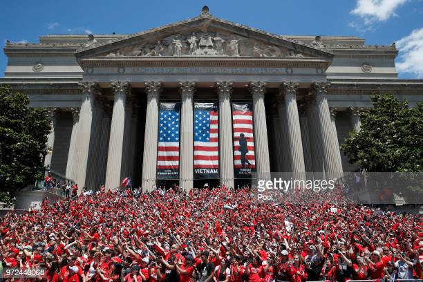 Fans crowd in front of the National Archives building as the NHL Stanley Cup champion Washington Capitals pass by on a victory parade June 12 in...