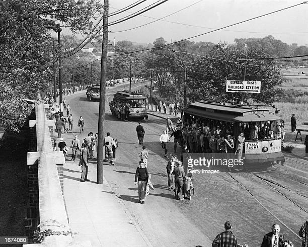 Fans crowd streetcars en route to the Yale Bowl to watch the Yale University football team play Cornell University New Haven Connecticut c 1940