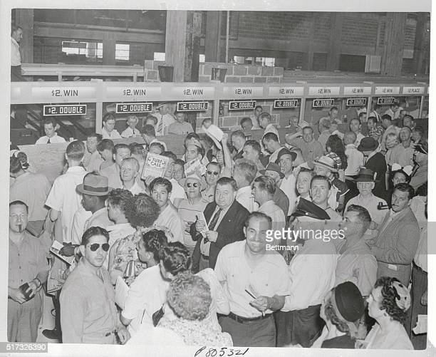 Fans crowd the $2 windows on the opening day of the new three and a half million dollar Atlantic City Race Track here on July 22 1946 The $10000...