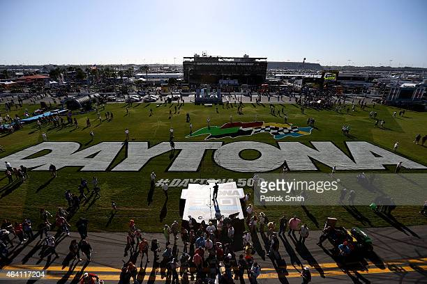 Fans crowd the infield prior to the NASCAR Sprint Cup Series 57th Annual Daytona 500 at Daytona International Speedway on February 22 2015 in Daytona...