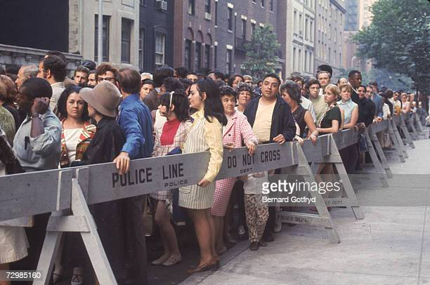 Fans crowd the police barricades along 81st Street in Manhattan to view the body of the late actresssinger Judy Garland at the Frank E Campbell...
