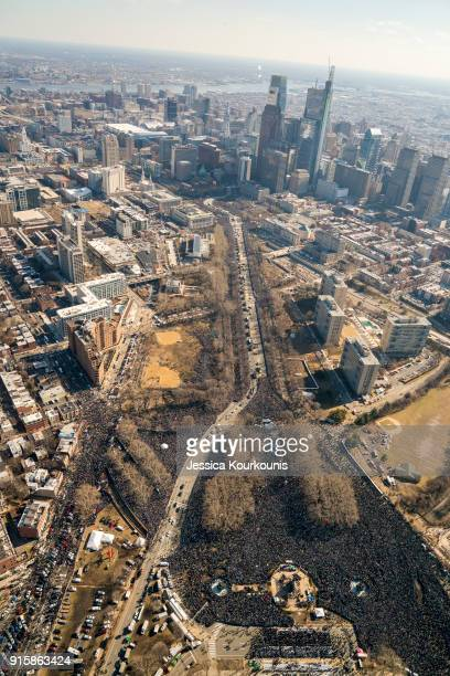 Fans crowd the streets to watch a Super Bowl victory parade for the Philadelphia Eagles NFL football team on February 8 2018 in Philadelphia...