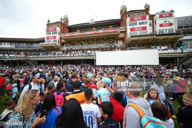 Fans crowd to see the World Cup Trophy during the England ICC World Cup Victory Celebration at The Kia Oval on July 15, 2019 in London, England.