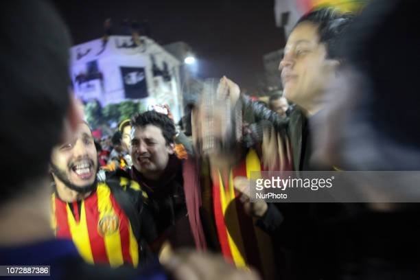 Fans dance and chant songs as they attend the celebrations of the 100th anniversary of the Tunisian soccer club Espérance Sportive de Tunis held in...