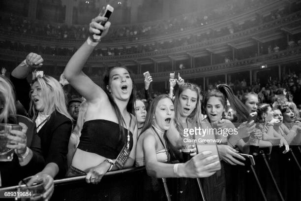 Fans dance and take selfies as drum and bass duo Sigma perform during the Albert Sessions live on stage at Royal Albert Hall on May 27 2017 in London...