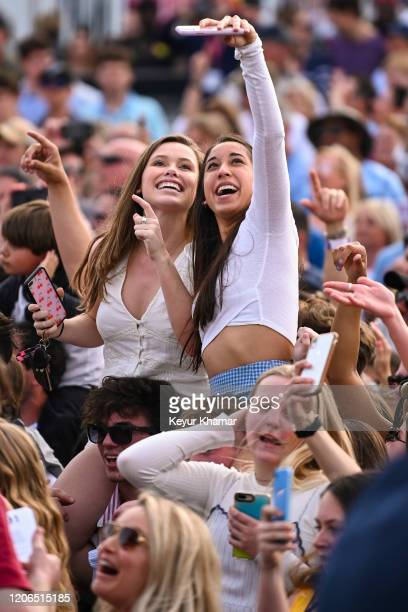 Fans dance and take selfies as The Chainsmokers perform during the Military Appreciation Day Ceremony and Concert for THE PLAYERS Championship on The...
