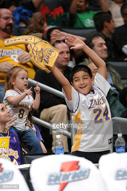 Fans dance during a break in the action of the game between the Tulsa 66ers and the Los Angeles DFenders at Staples Center on December 7 2008 in Los...