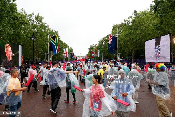 Fans dance during the ICC Cricket World Cup 2019 Opening Party at The Mall on May 29 2019 in London England