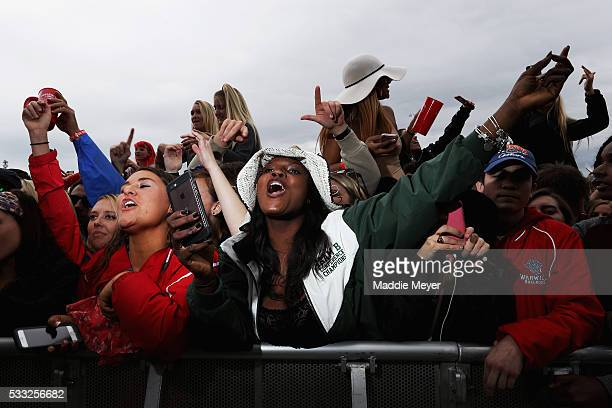 Fans dance to a Fetty Wap performance in the infield before the 141st running of the Preakness Stakes at Pimlico Race Course on May 21 2016 in...