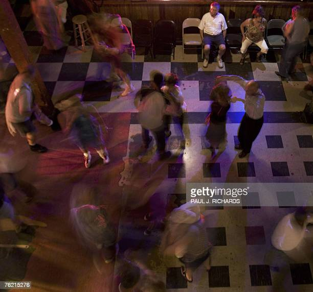Fans dance to the Bruce Daigrepont Cajun Band with Cajun and Zydeco style music 19 August 2007 at Tipitina's in New Orleans,Louisiana. Daigrepont has...