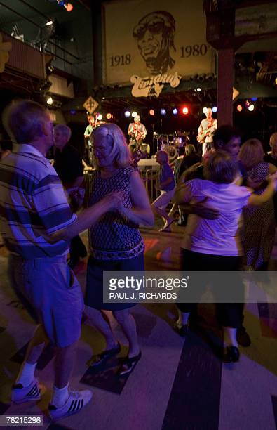 Fans dance to the Bruce Daigrepont Cajun Band with Cajun and Zydeco style music 19 August 2007 in New Orleans, Louisiana. Daigrepont has performed at...