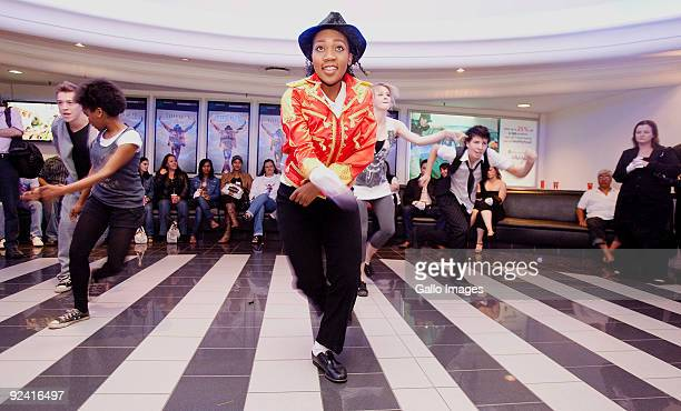 Fans dance to the music of Michael Jackson at the South African premiere of This is It at the Ster Kinekor cinemas in Fourways on October 28 2009 in...
