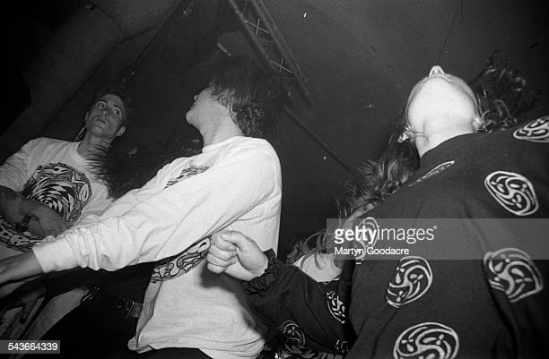 Fans dancing in the audience at a gig by Five Thirty wearing early 1990s indie fashions at the Zap Club, Brighton, United Kingdom, 1990.