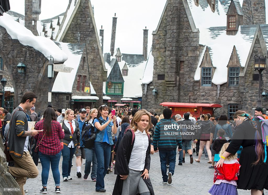 Fans discover Hogsmeade at the Grand Opening of the 'Wizarding World of Harry Potter' to the public at Universal Studios Hollywood, in Universal City, California, on April 7, 2016. Fifteen years after Harry Potter's first big screen adventure, Universal is enchanting a new generation of Muggles with its most spectacular conjuring trick yet -- a theme park in the heart of Hollywood. / AFP / VALERIE