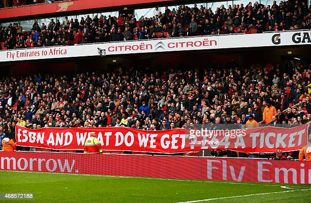Fans display a banner about the price of tickets during the Barclays Premier League match between Arsenal and Liverpool at Emirates Stadium on April...