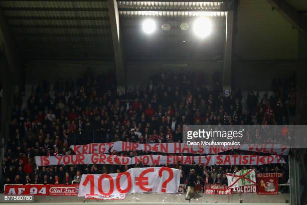 Fans display a banner as they protest about ticket prices during the UEFA Champions League group B match between RSC Anderlecht and Bayern Muenchen...