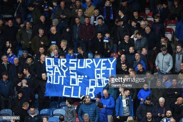 Fans display a banner during the Premier League match between Huddersfield Town and Everton at John Smith's Stadium on April 28 2018 in Huddersfield...