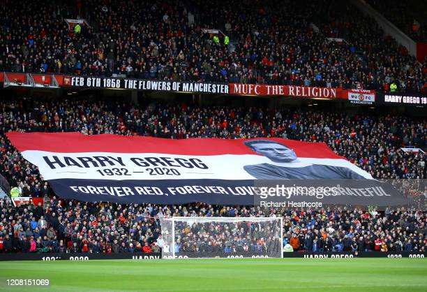 Fans display a banner in tribute to former Manchester United player Harry Gregg prior to the Premier League match between Manchester United and...