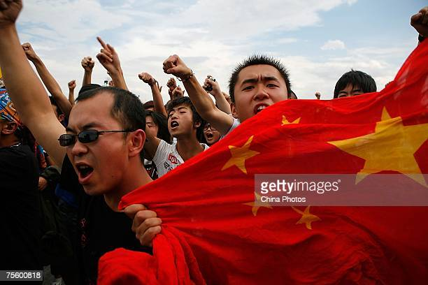 Fans display a Chinese national flag at the first 'Green Flag Erdos Grassland Rock Music Festival' near the Mausoleum of Genghis Khan on July 21 2007...
