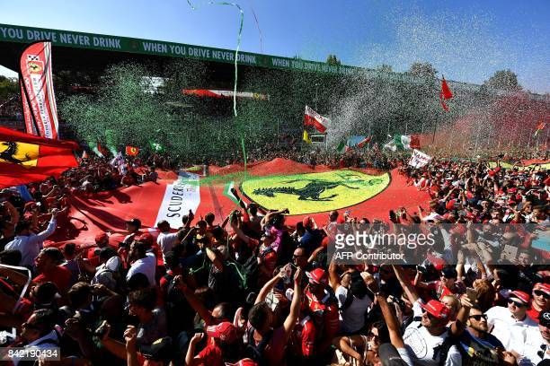 Fans display a giant Scuderia Ferrari banner as they celebrate after the Italian Formula One Grand Prix at the Autodromo Nazionale circuit in Monza...