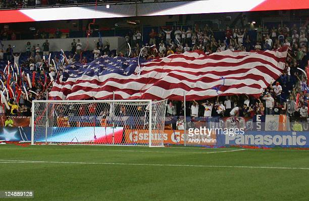 Fans display a large american flag during the game between the New York Red Bulls and the Vancouver Whitecaps FC during the game at Red Bull Arena on...