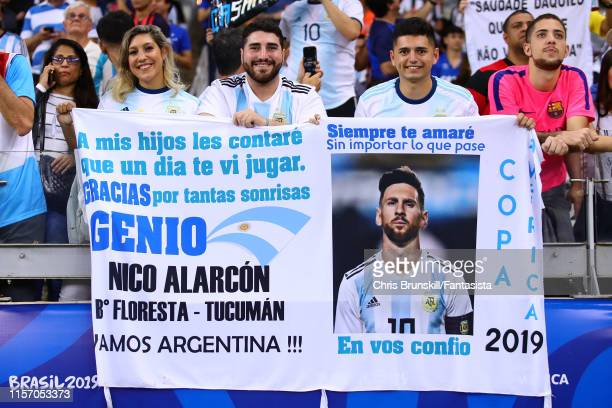 Fans display a Lionel Messi of Argentina banner during the Copa America Brazil 2019 group B match between Argentina and Paraguay at Mineirao Stadium...