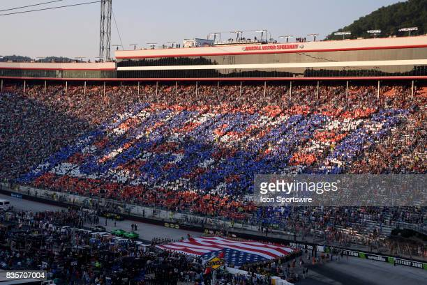 Fans display a USA logo during the singing of the National Anthem before the start of the Bass Pro Shops NRA Night Race on August 19 at the Bristol...