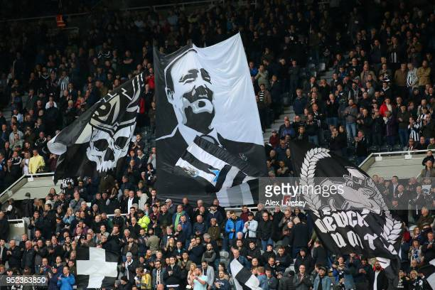 Fans display banners of Rafael Benitez, Manager of Newcastle United during the Premier League match between Newcastle United and West Bromwich Albion...