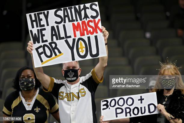 Fans display signs before the game at the Mercedes-Benz Superdome on October 25, 2020 in New Orleans, Louisiana.