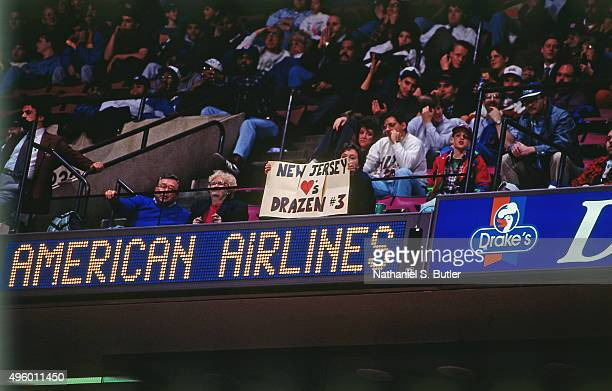 Fans display signs for former New Jersey Nets player Drazen Petrovic prior to a game against the Indiana Pacers on November 11 1993 at Continental...
