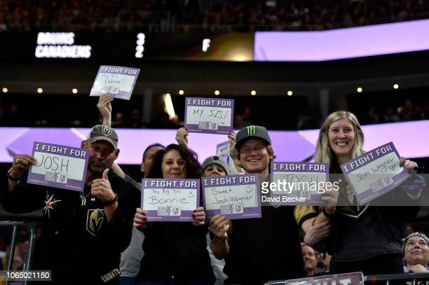 Fans display signs in support of the Hockey Fights Cancer initiative during a game between the San Jose Sharks and Vegas Golden Knights at TMobile...