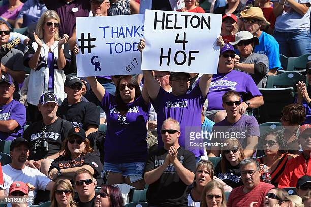 Fans display signs in support of Todd Helton of the Colorado Rockies against the St Louis Cardinals at Coors Field on September 19 2013 in Denver...