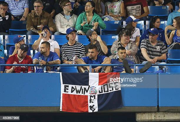 Fans display the flag of the Dominican Republic with the names of Edwin Encarnacion of the Toronto Blue Jays and Jose Bautista during MLB game action...