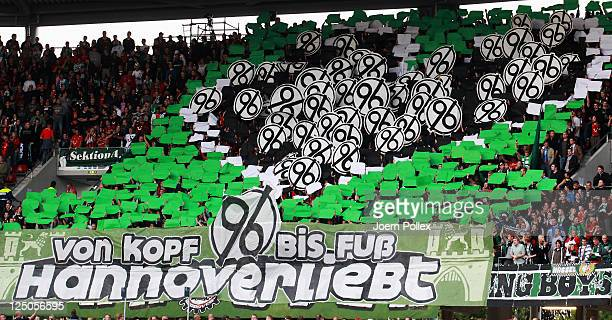 Fans display their clubs logo prior to the UEFA Europa League Group B match between Hannover 96 and R Standard de Liege at AWD Arena on September 15...