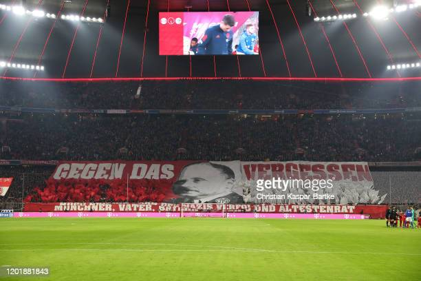 Fans displays a banner reading 'Gegen das Vergessen' or 'Lest We Forget' in memory of victims of The Holocaust prior to the Bundesliga match between...