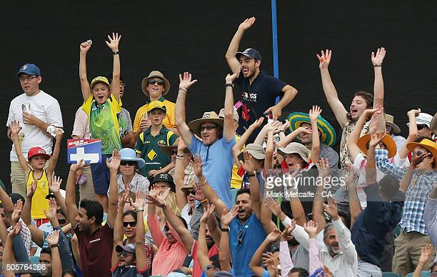 Fans do a mexican wave during the Victoria Bitter One Day International match between Australia and India at Manuka Oval on January 20 2016 in...