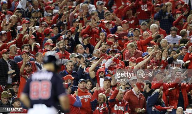 Fans do the Baby Shark cheer as Gerardo Parra of the Washington Nationals bats in the sixth inning against the St Louis Cardinals during game four of...
