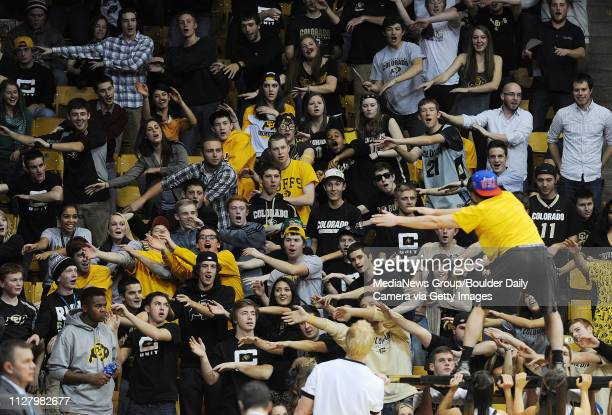 CU fans do the roller coaster to start the second half of the December 13 2013 game in Boulder