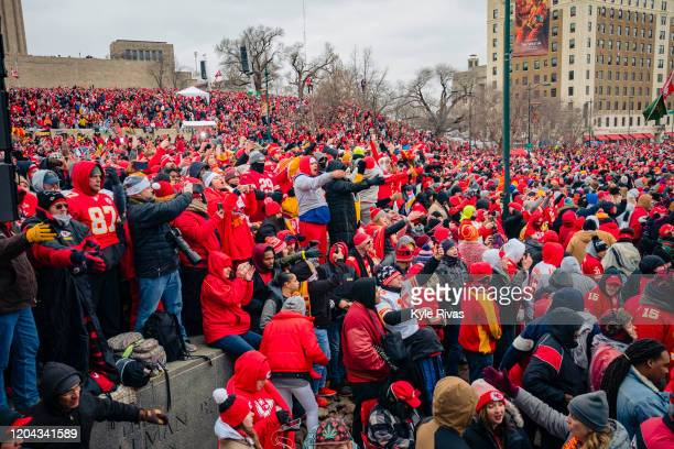 Fans do the tomahawk chop during the Kansas City Chiefs Victory Parade on February 5 2020 in Kansas City Missouri
