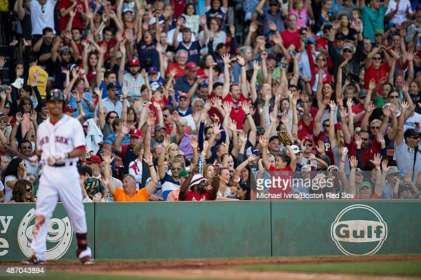 Fans do the wave as Mookie Betts of the Boston Red Sox steps up to the plate during the fourth inning against the Philadelphia Phillies at Fenway...