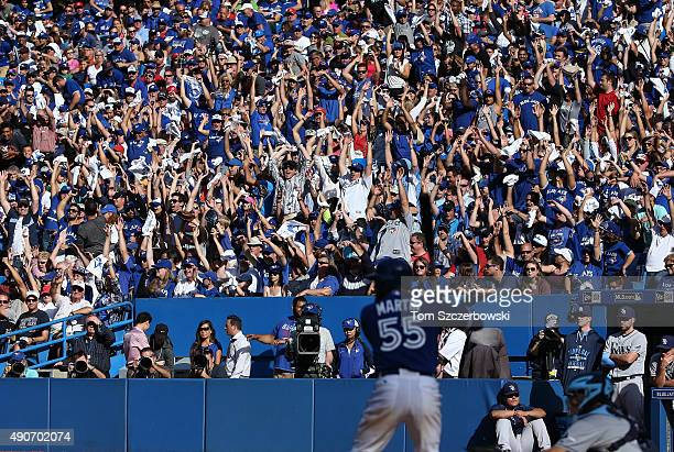 Fans do the wave as Russell Martin of the Toronto Blue Jays bats during MLB game action against the Tampa Bay Rays on September 26 2015 at Rogers...