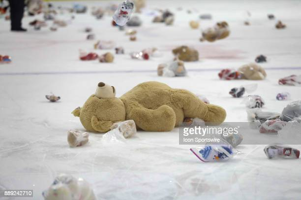 Fans donated stuffed animals for Christmas gifts following a college hockey match between the University of Wisconsin Badgers and the University of...