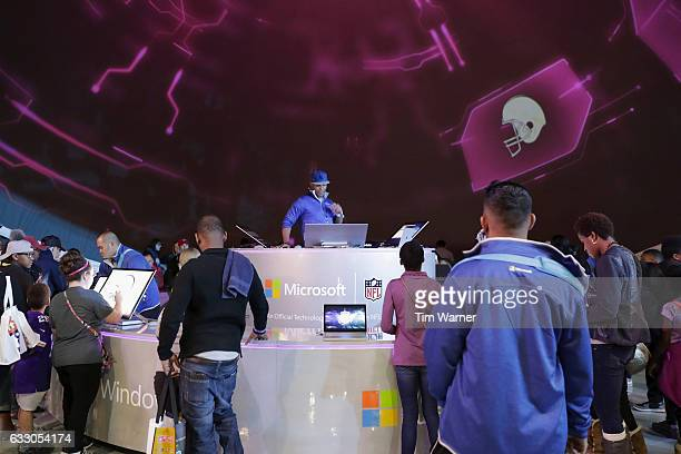 Fans draw custom designed football uniforms on Microsoft Surface Pro screens at the NFL Experience on January 29 2017 in Houston Texas
