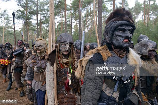 Fans dressed as characters from The Hobbit book march through the forest near the village of Doksy some 80 km from Prague on June 4 2016 The epic...