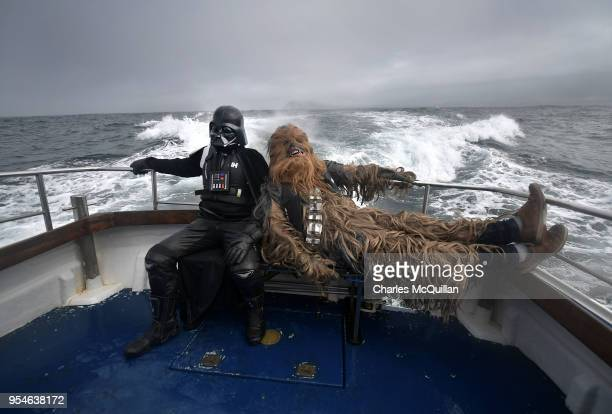 Fans dressed as Darth Vader and Chewbacca take a boat trip to the Skelligs on May 4 2018 in Portmagee Ireland The first ever Star Wars festival is...