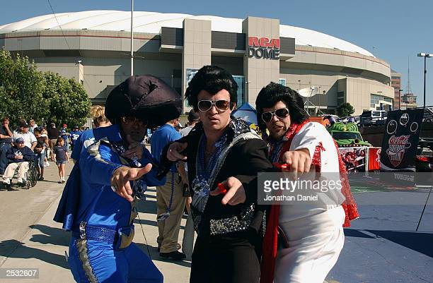 Fans dressed as Elvis Presley pose in front of the RCA Dome before a game between the Indianapolis Colts and the Jacksonville Jaguars at the RCA Dome...