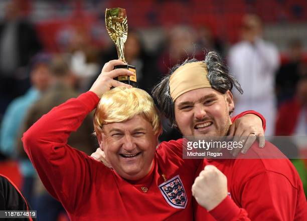 Fans dressed as former England players enjoy the pre match atmosphere prior to the UEFA Euro 2020 qualifier between England and Montenegro at Wembley...