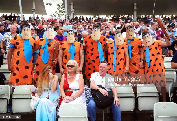 Fans dressed as Fred Flintstone pose for a photo during day three of the Ashes Test match at Edgbaston Birmingham
